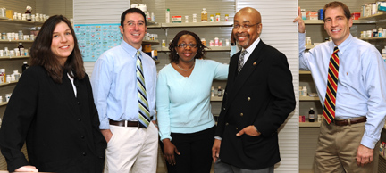 Three College of Pharmacy faculty members, from left, Drs. Gayle Kamm, Todd Gundrum and Basirat Sanuth earned certification as pharmacotherapy specialists from the Washington, D.C.-based Board of Pharmaceutical Specialties. Congratulating them are College of Pharmacy Dean Johnnie Early II, left, and Dr. Steven Martin.