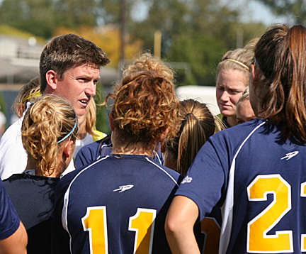 Head Soccer Coach Brad Evans talked to his team during a timeout.