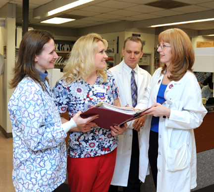 Conferring about a patient care plan are, from left, Deana Sievert, medical coronary care unit (MCCU), intermediate coronary care unit (ICCU), surgical intensive care unit and remote cardiac monitoring station nursing director, Jackie Bury, MCCU/ICCU lead nurse; Russ Smith, pharmacy operations manager; and Sherry Scotton, clinical pharmacist.