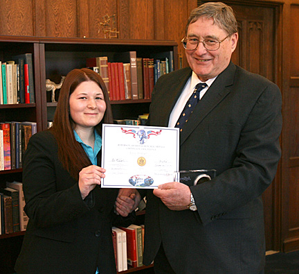 Emily Stinehart receives the University's first Jefferson Award from President Lloyd Jacobs.