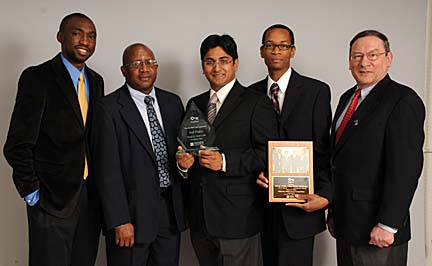 Bringing home third place from the Minority MBA Case Competition V were, from left, Uyi Eguasa, team adviser Dr. Ainsworth Bailey, Gaurav Mehta and Jonathan Johnson, who posed for a photo along with David Chatfield, director of the UT MBA and EMBA programs.