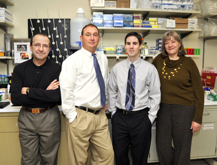 Terry Hinds Jr., second from left, and Damien Earl, third from left, are recipients of NIH National Research Service awards for individual predoctoral research fellowship training. At left is Hinds' adviser, Dr. Edwin Sanchez, a , professor of physiology/pharmacology and CeDER assistant director, and Dr. Elizabeth Tietz, professor and vice chair of physiology/pharmacology, who is Earl's adviser.