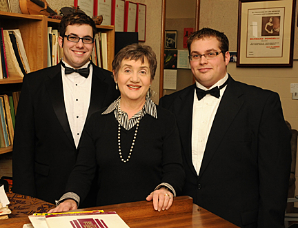 Barbara Rondelli Perry posed for a photo with her students Sam Mason, left, and Dusty Selman.