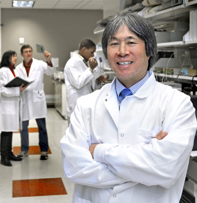 Dr. Bryan Yamamoto posed for a photo in his lab.