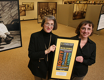 "Barbara Floyd, left, and Kim Brownlee hold the 2008 Community Access Award the Canaday Center received from the Ability Center of Greater Toledo for the exhibit, ""From Institutions to Independence: A History of People With Disabilities in Northwest Ohio."""