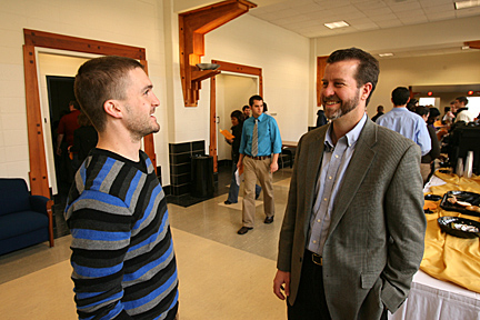 Tyler Campbell, left, talked with Dr. Martin Ohlinger during a break at the recent program in the Student Union, where pharmacy students gave research presentations.