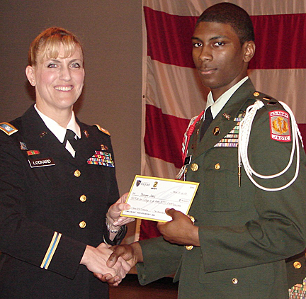 Lt. Col. Brandee Lockard, UT professor and chair of military science, congratulated Dwayne Jones on receiving a full ride to college from the U.S. Army and selecting The University of Toledo.