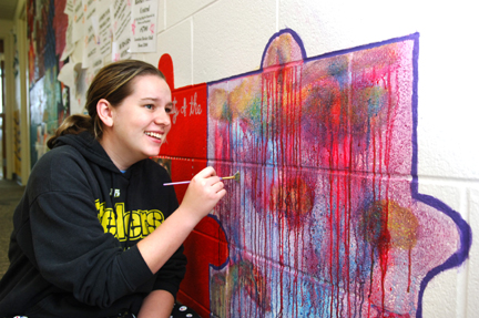 Freshman Ashley Raiders added some color to a puzzle piece in the Arts Living and Learning Community living quarters.