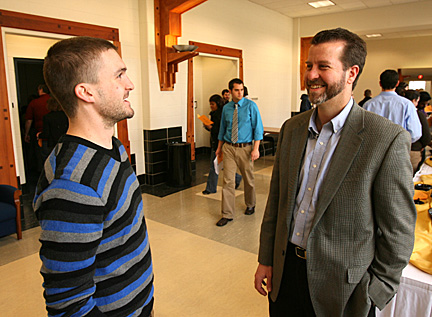 Tyler Campbell, left, talked with Dr. Martin Ohlinger.