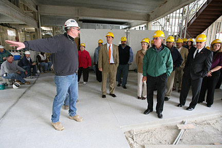 Mark Makovic of Wilson Builders led a tour group through the Savage & Associates Complex for Business Learning and Engagement last week following the announcement that UT received a Kresge Foundation Challenge Grant for $900,000 toward constructing and equipping the complex.