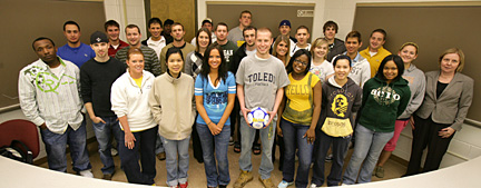 Billy, holding the soccer ball, posed for a photo with Kathleen Fitzpatrick, far right, and her accounting class.