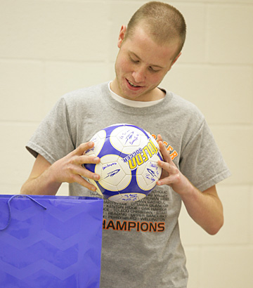 Billy, a soccer player and fan, checked out a ball signed by members of the UT women's soccer team.