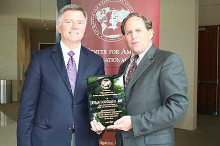UT Law Dean Doug Ray, left, received a plaque from Mark Smith of the Center for American and International Law.