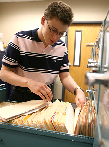 Josh Hoye works on the files in the UT Treasurer's Office.