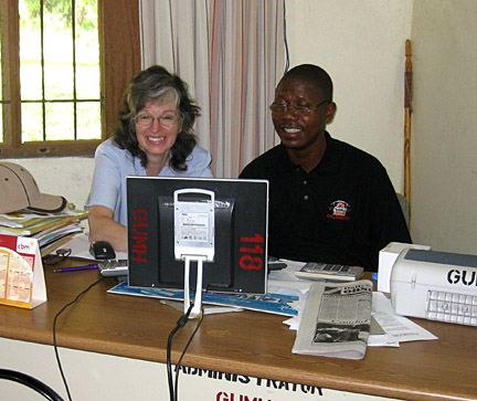 Janice Flahiff and Victor Taylor, an administrator at Ganta Nursing School, check out Web sites.