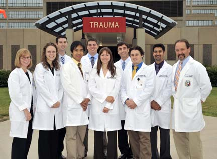 Dr. Catherine Marco, residency program director, left, and Dr. Kris Brickman, chairman of UT's Department of Emergency Medicine, right, posed with the new emergency medicine residents on the helipad outside UT Medical Center.