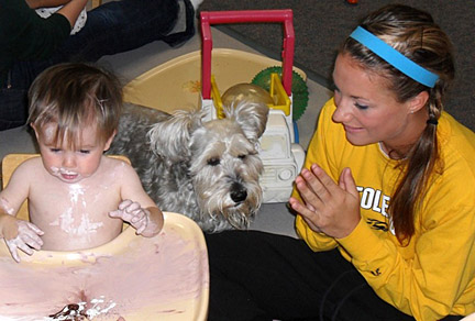 Sophomore utility player Melissa Rons cheered on some finger painting during a visit to Apple Tree Nursery School.