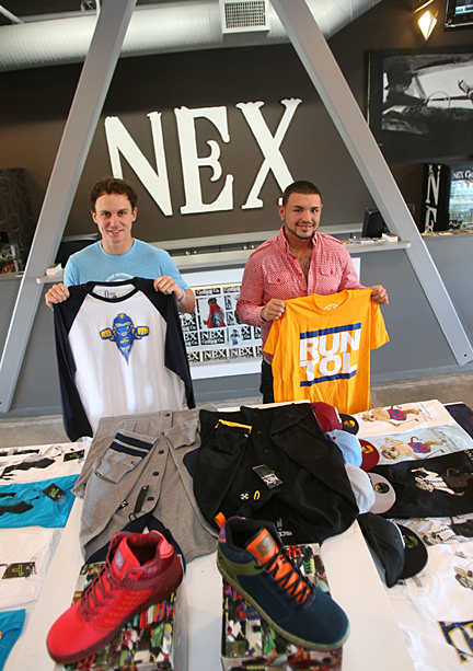 John Amato, left, showed off one of his shirt designs and UT student Zach Beebe held up a T-shirt in the NEX Clothing Co.