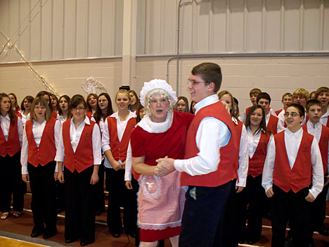 Mrs. Santa Claus (Sue Kielczewski) danced with a student from Oak Harbor Middle School as part of last year's annual holiday program.