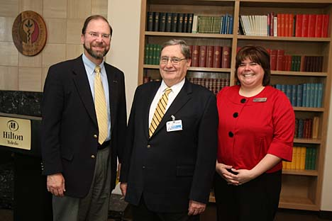 Dr. Brian Randolph, left, posed for a photo with President Lloyd Jacobs and Michele Martinez, interim dean of students, after winning the 2008-09 Students First Award.