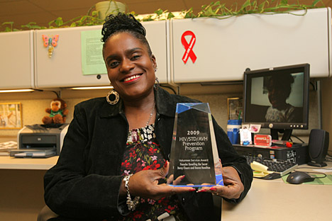 Darcy Chears showed off the HIV Volunteer Service Award she received from the Ohio Department of Health.