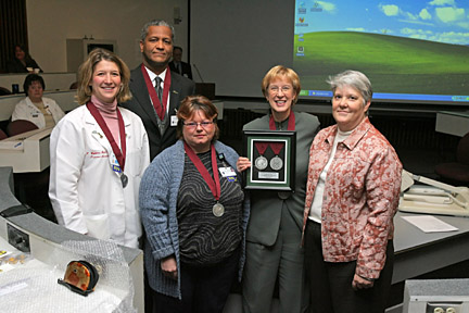Mark Chastang joined, from left, Kristen Calkins, Cindy Schneider and Norma Tomlinson to accept Silver Medals of Honor from the U.S. Department of Health and Human Services for increasing the number of organs available for transplant. Carolyn Ruge of Life Connection of Ohio, far right, also attended the ceremony.