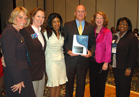 Dr. Clint Longenecker posed for a photo with the 2009 Toastmasters International Communications and Leadership Award with Toastmaster officers, from left, Lt. Gov. of Education and Training Vera Johnson, International Director Kristal DiCarlo, Lt. Gov. of Marketing Robynn Diamond, District Gov. Nancy Zychowicz and Area 3 Gov. and Fall  Conference Chair Heather Lane, who is an alumna of the UT College of Business Administration.