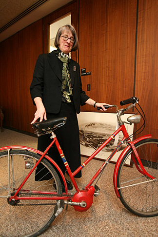Barbara Floyd showed off a bicycle fitted with a three-speed Dana transmission circa 1970. The bike is among the Dana Holding Corp. items now housed in the Canaday Center for Special Collections.