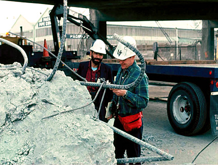 Dr. Mark Pickett, right, and then UT doctoral student Dr. Omar Abu-Yasein examined a failed column from the I-880 bridge that collapsed during the 1989 San Francisco earthquake.