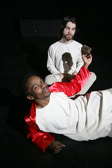 """The devil, portrayed by Phillipe Taylor, tries to tempt Jesus, played by Pat Miller, to turn stone into bread in the """"Creation/Doomsday: Selections From the Chester Mystery Cycle."""""""