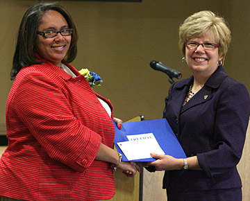 Dr. Rosemary Haggett, right, presented an Outstanding Women Award to Vandra Robinson.