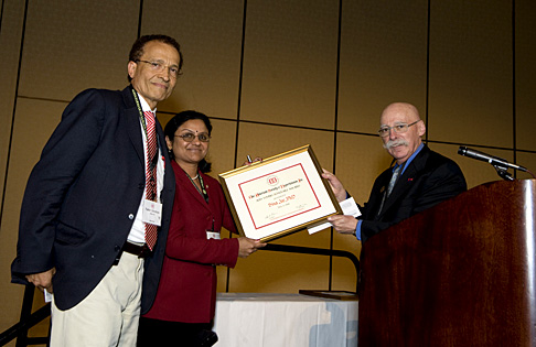 Dr. Bina Joe received the Young Scholar Award from the American Society of Hypertension from the organization's president, Dr. Henry R. Black. Dr. Nader Abraham, UT professor and chair of the Department of Physiology and Pharmacology, was in New York for the presentation at the society's annual meeting.