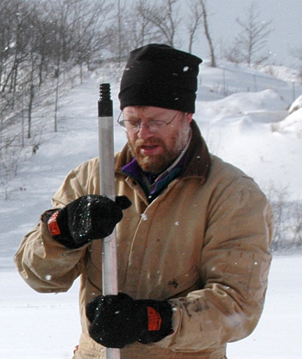 Dr. Timothy Fisher, shown here three years ago with a thrust rod of a corer, which he used to recover 1-meter segments of sediment cores from lake ice on Goshorn Lake, an inland lake next to Lake Michigan south of Holland, Mich., conducted similar research on small lakes around Lake Superior.