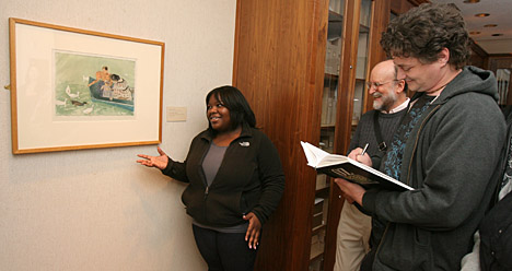 """Jasmine Gordon, a junior majoring in social work, talked about Mary Cassatt's """"Feeding the Ducks"""" as Dr. Marc Gerstein, center, listened and Johnathon Antalek, a junior majoring in new media, took notes. The painting is part of the """"Strong Sensations: Impressionist and Symbolist Works on Paper, 1860-1900"""" exhibition."""