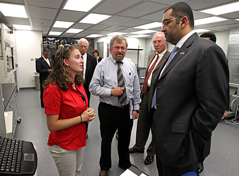 Rosa Zartman, research associate at the Wright Center for Photovoltaics Innovation and Commercialization (PVIC), spoke with Dr. Sultan Al Jaber as, from left, Dr. Robert Collins and Dr. Frank Calzonetti listened. During his visit, Al Jaber toured several UT locations, including the PVIC labs.