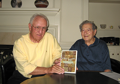 "Bud Fisher, left, holds a copy of his book, ""What a Time it Was: Interviews With Northwest Ohio Veterans of World War II,"" which includes an interview with Alvin Dickson, right, who received a bronze star for his service."