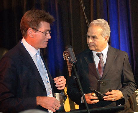 Dr. Vijay Goel, center, received the Wiltse Lifetime Achievement Award from Robert Moore, secretary of the International Society for the Study of the Lumbar Spine.