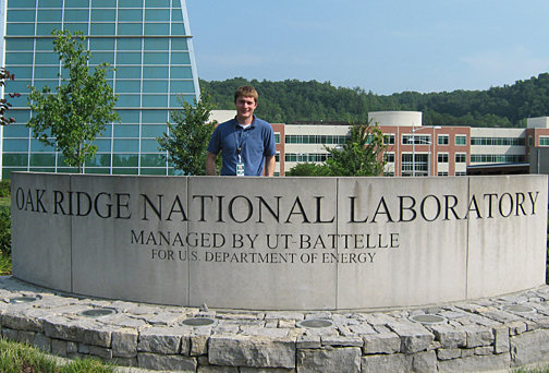 Jeffrey Kodysh posed for a photo by the Oak Ridge National Laboratory Sign.