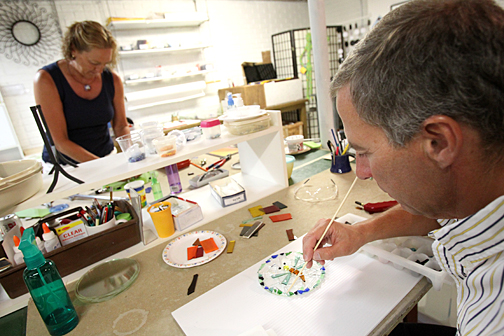 Bob and Deb Less prepared glass pieces for the kiln in their studio in Holland, Ohio.