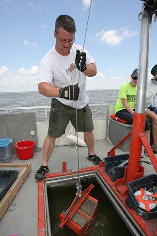 Todd Crail, UT graduate student in biology, prepared to lower away, collecting samples from Lake Erie that researchers hope will reveal patterns in aquatic communities.