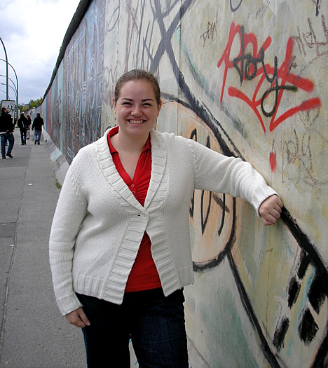 Emma Blandford posed for a photo by a remaining section of the Berlin Wall during a trip to Germany a few years ago.