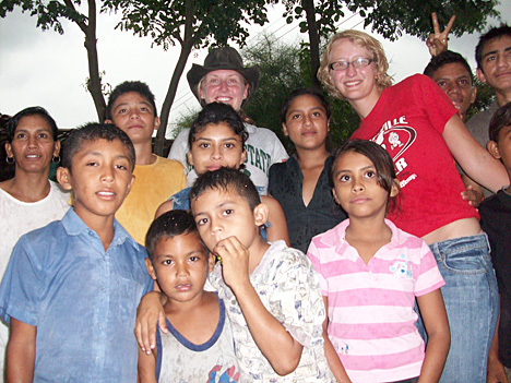 Erin Nichols, left, and Emma Boff, members of the UT Engineers Without Borders student chapter, posed for a photo with children during a visit to Honduras.