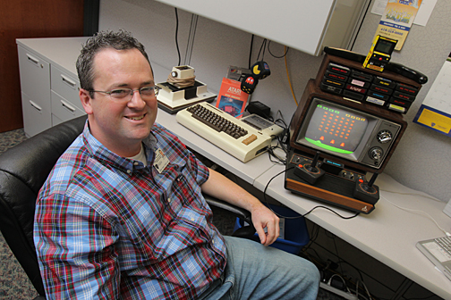 Don Curtis shows off the classic Atari in his office.