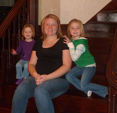 Kelli Chovanec and her daughters, Kathryn, left, and Breann, posed for a photo on the stairs of their new home in Delta.