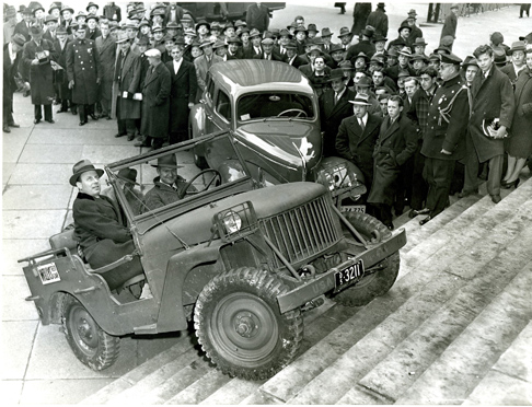 This 1940 photo in the exhibit shows the Willys-Overland Jeep test  vehicle being driven up the steps of a building in Washington, D.C., to  show off its versatility. The company produced 1,500 models for the  government in 75 days to help the war effort.