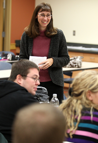 Dr. Debra Johanning, shown here sharing a laugh with students in the Teaching Problem Solving in Mathematics class last week, received an Early Career Grant from the National Science Foundation to develop materials to support instructors teaching mathematics.
