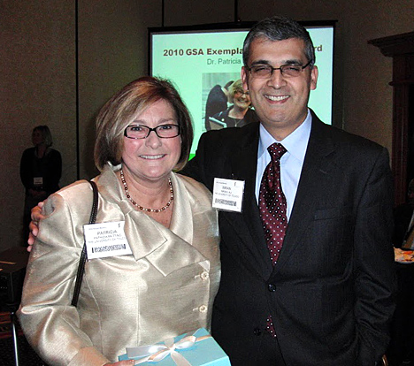 Dr. Patricia Metting posed for a photo with UT colleague Dr. Imran Ali after the award ceremony.
