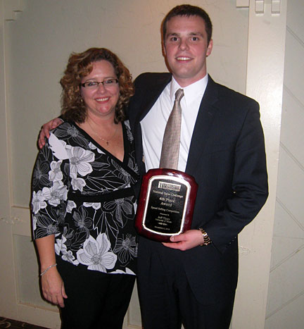 Jeff Tippy posed for a photo with his award and Dr. Ellen Pullins.