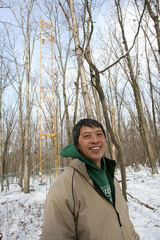 Dr. Jiquan Chen stood in front of the flux tower at Oak Openings Metropark in this photo taken in January. He provided measurements from this and other towers to the study recently published in Nature that presented a global view of evapotranspiration from 1982 to 2008.