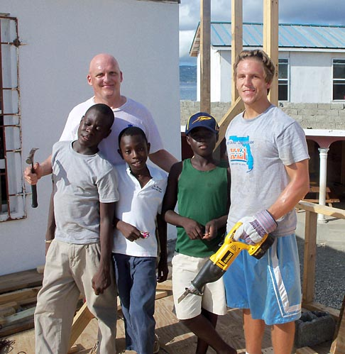 Dr. Clinton Longenecker and his son, Clint Jr., took a break from helping to build an orphanage in Port-de-Paix to pose for a photo with some orphaned Haitian children.